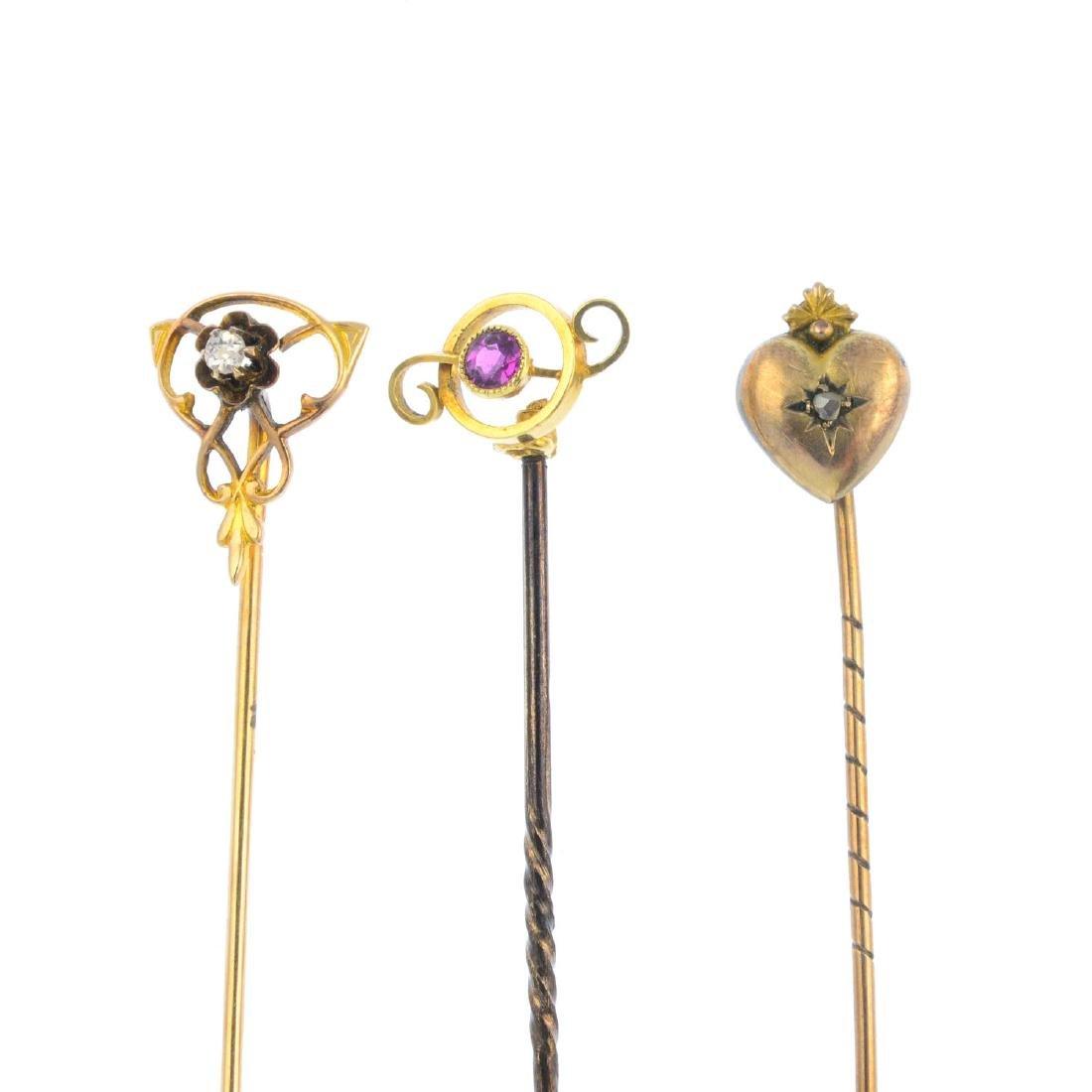 Three early 20th century gem-set stickpins. Designs to
