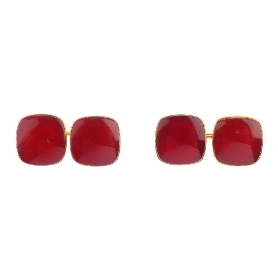 A pair of carnelian cufflinks. Each designed as two