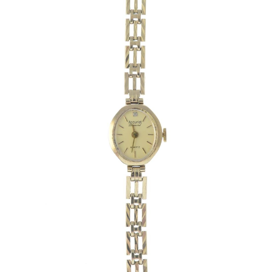 ACCURIST - a 9ct gold lady's bracelet watch. The oval