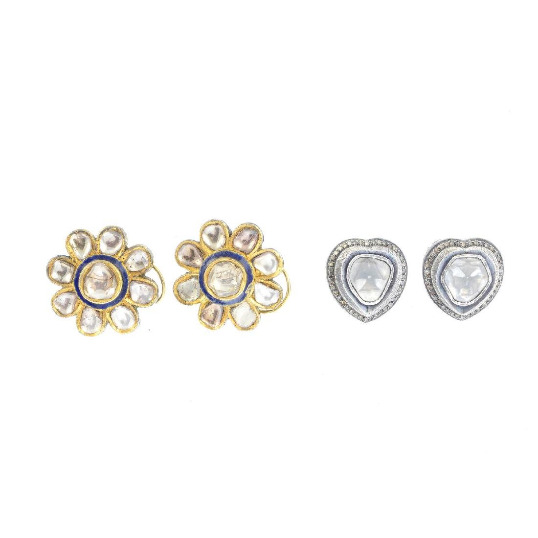 (206296) Two pairs of diamond earrings. The first pair