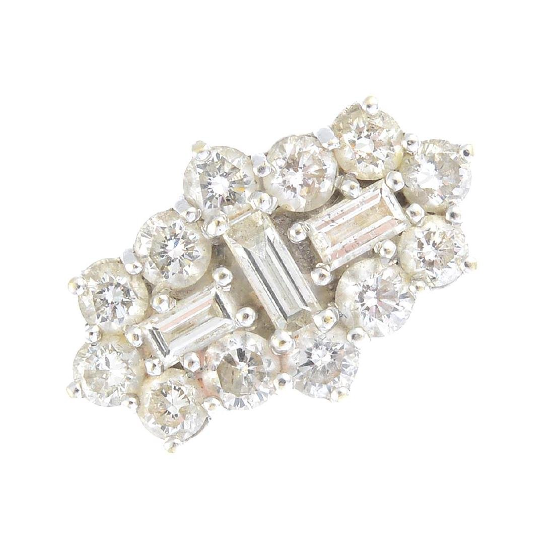 (203503) An 18ct gold diamond cluster ring.  The