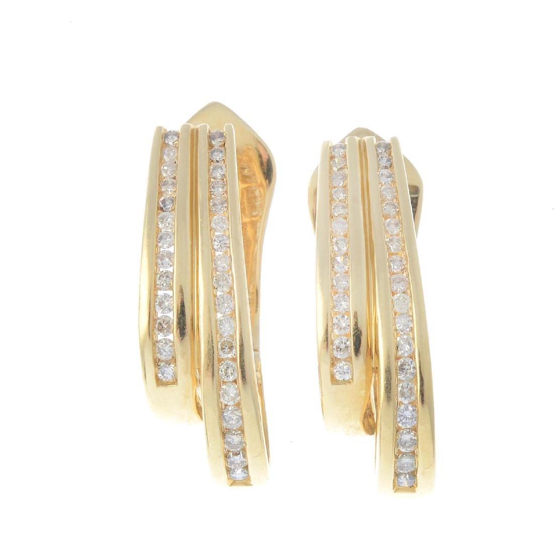 (205872) A pair of diamond earrings. Each designed as