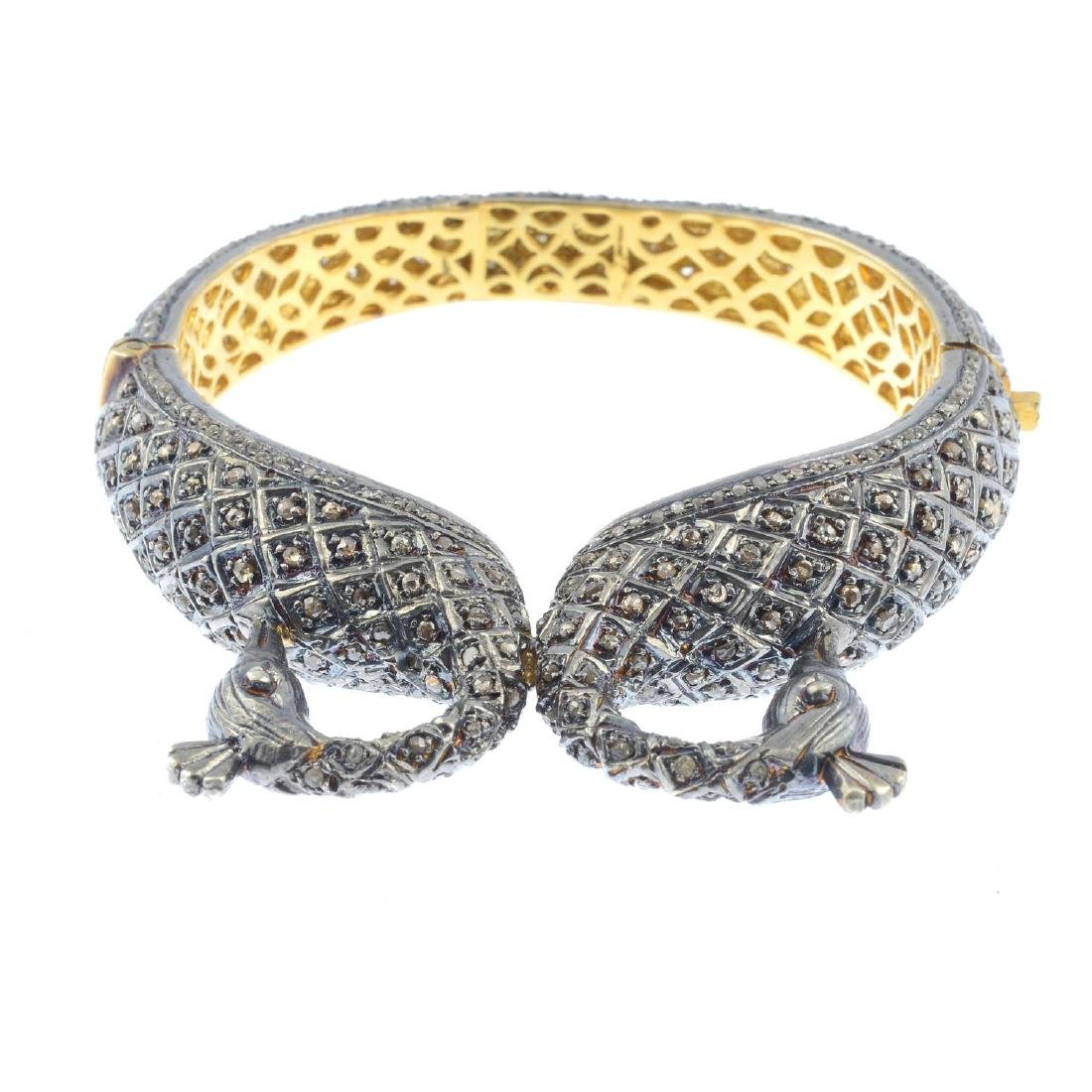(205872) A diamond hinged bangle. Designed as two