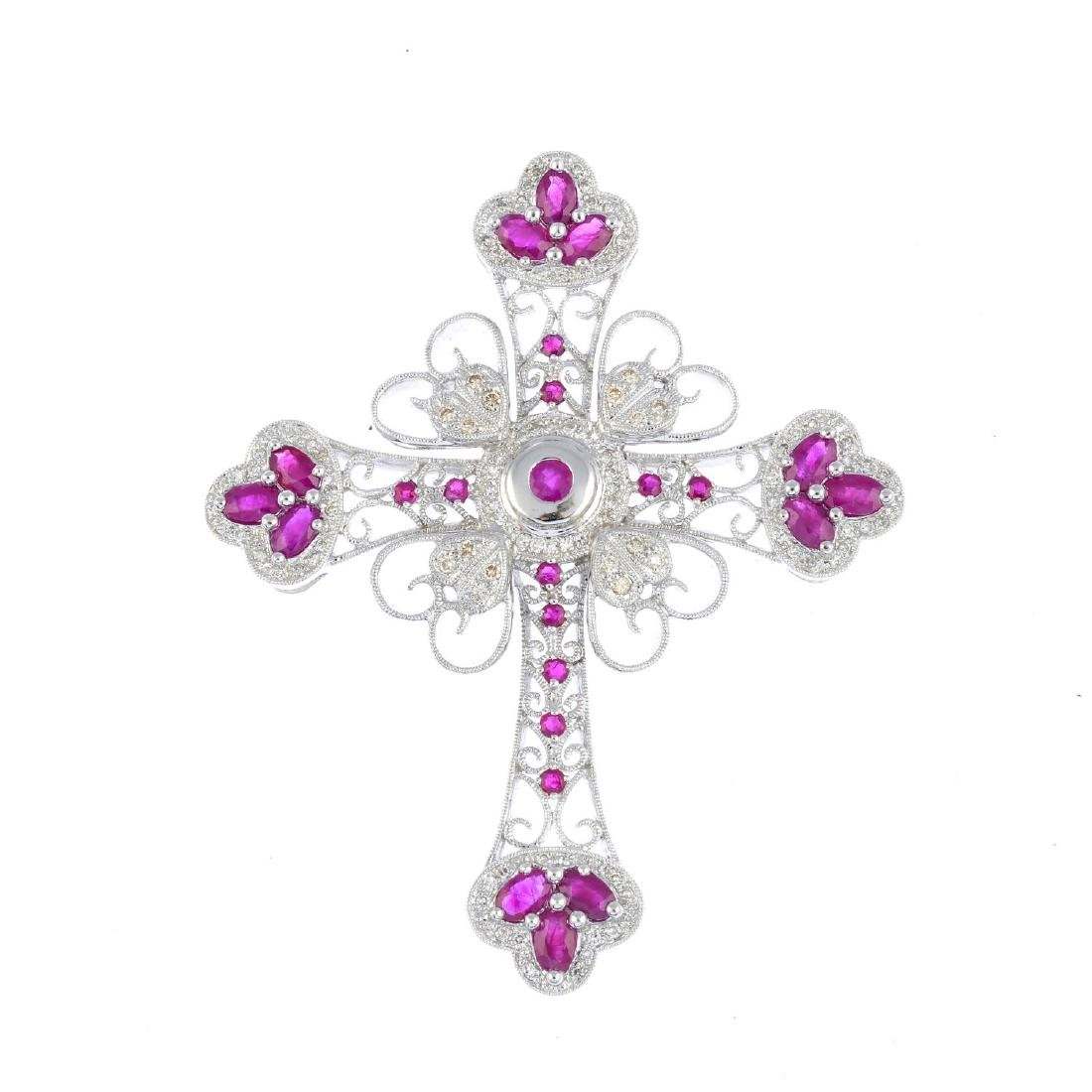 (205872) A ruby and diamond cross pendant. Of openwork