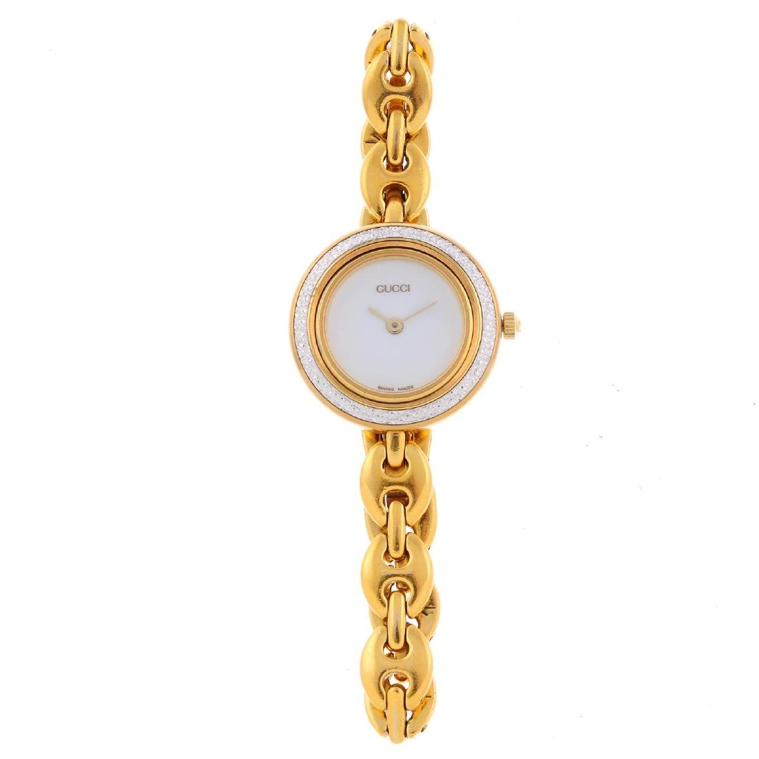 GUCCI - a lady's bracelet watch. Gold plated case with