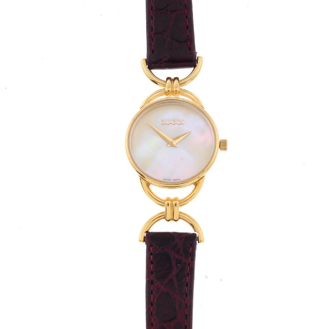 GUCCI - a lady's 6000.2.L wrist watch. Gold plated