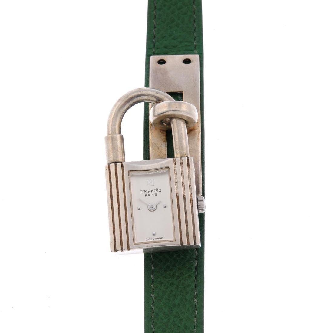 HERMÈS - a lady's Kelly wrist watch. Silver padlock