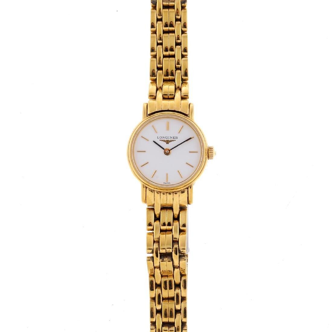 LONGINES - a lady's Presence bracelet watch. Gold