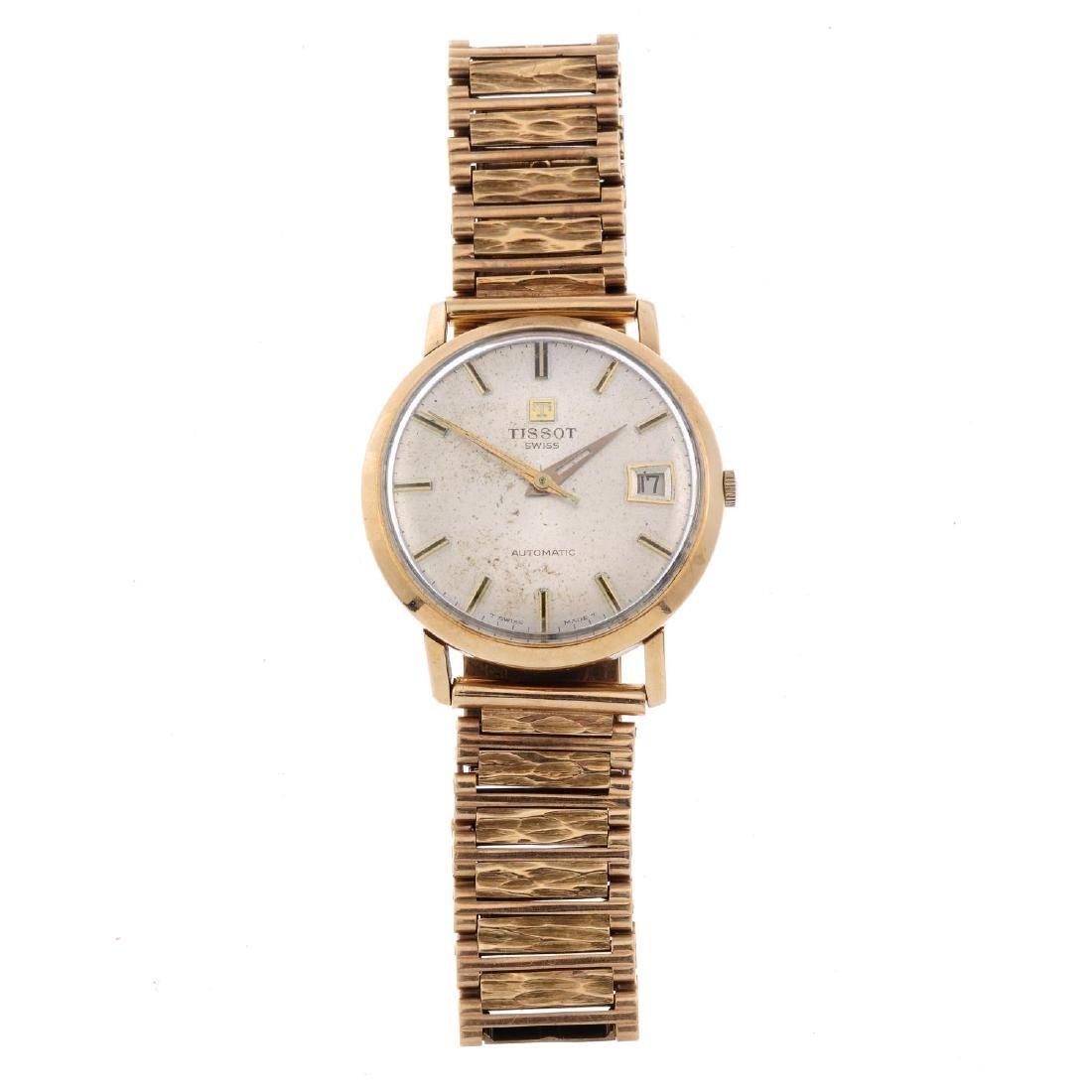 TISSOT - a gentleman's bracelet watch. 9ct yellow gold