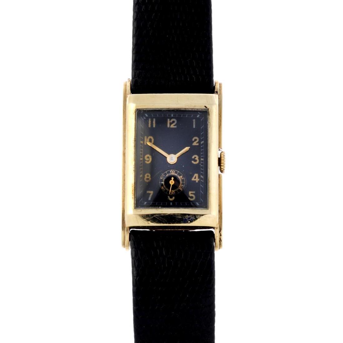 A gentleman's wrist watch. Yellow metal case, stamped