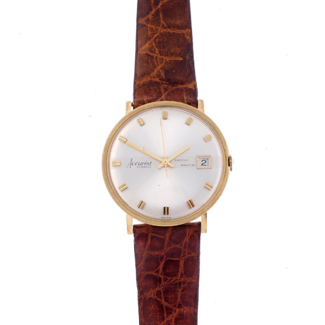 ACCURIST - a gentleman's Shock-Master wrist watch. 9ct