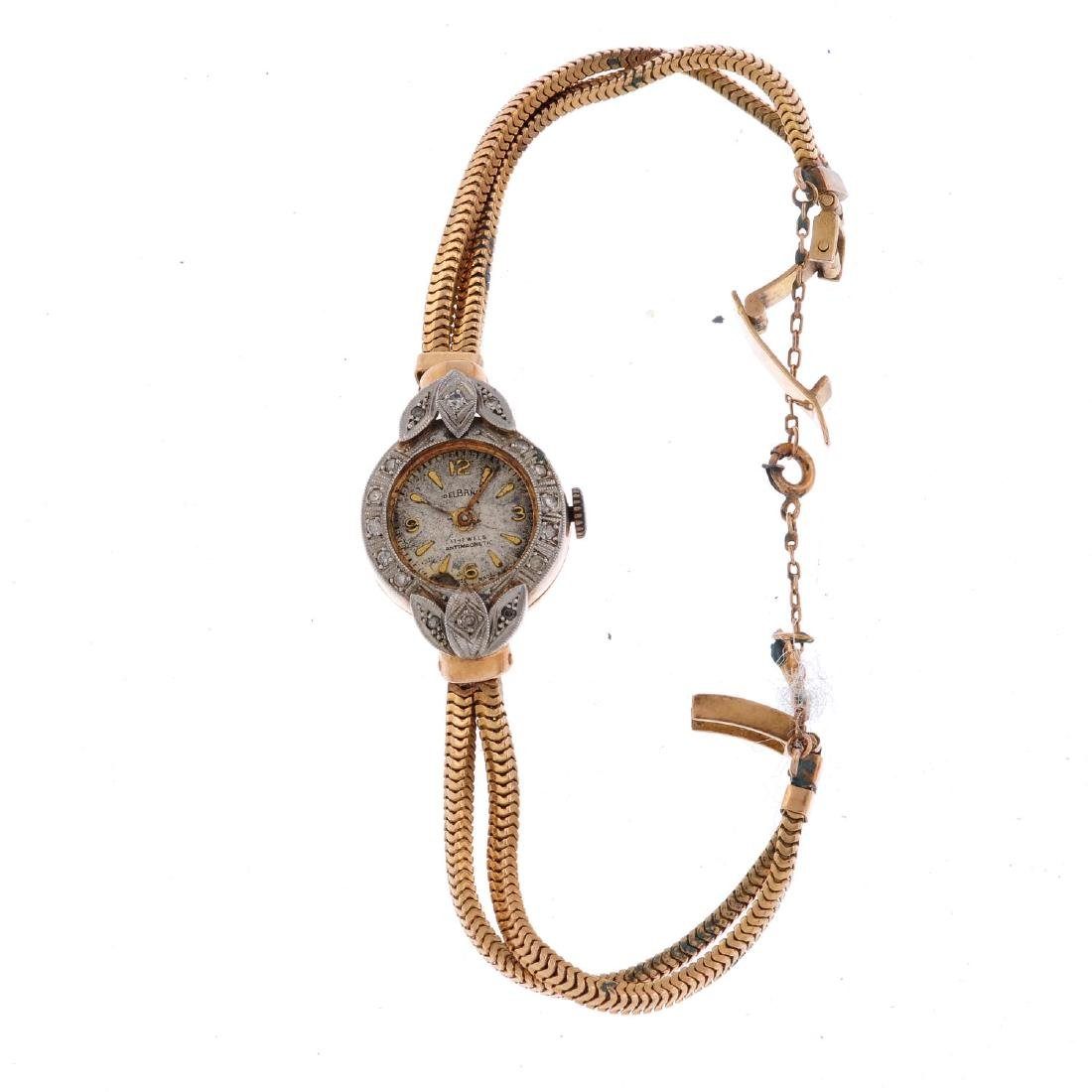 DELBANA - a lady's cocktail  watch. Yellow metal