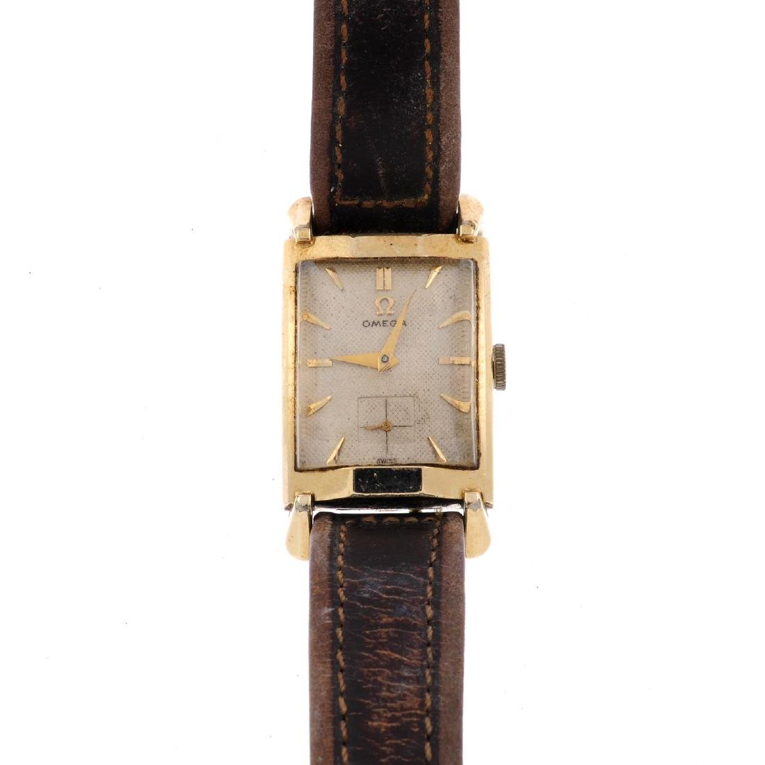 OMEGA - a gentleman's wrist watch. Rolled gold case.