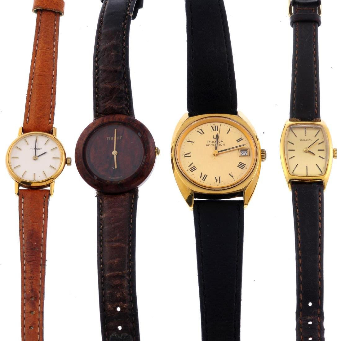 A group of four assorted watches, to include examples