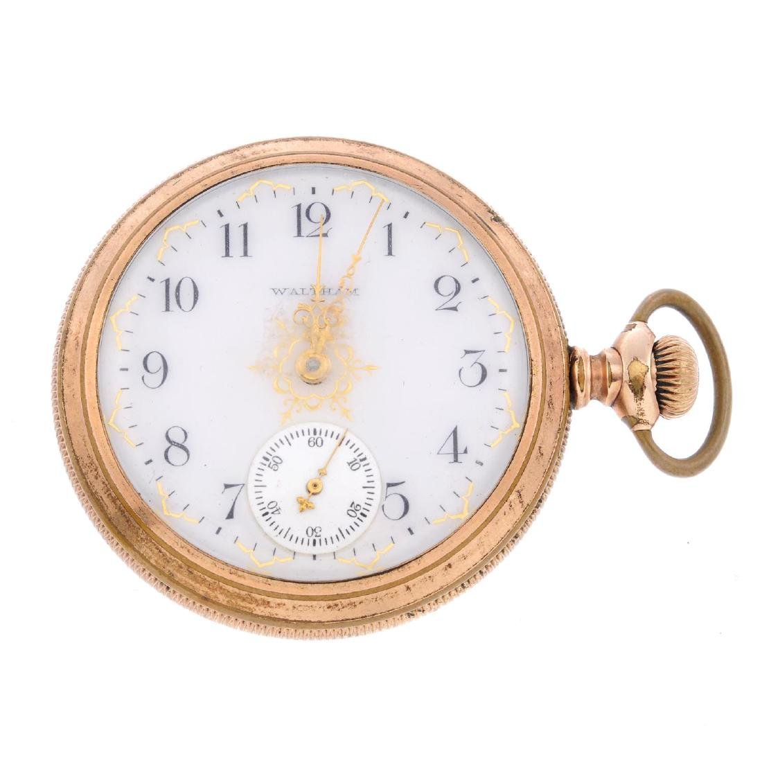 An open face pocket watch by Waltham. Gold plated case.