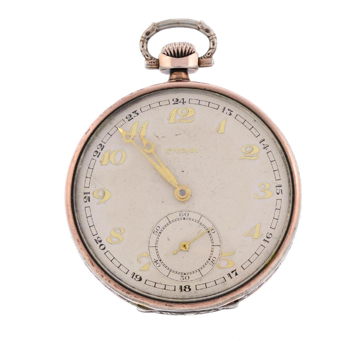 An open face pocket watch by Eterna. White metal case,