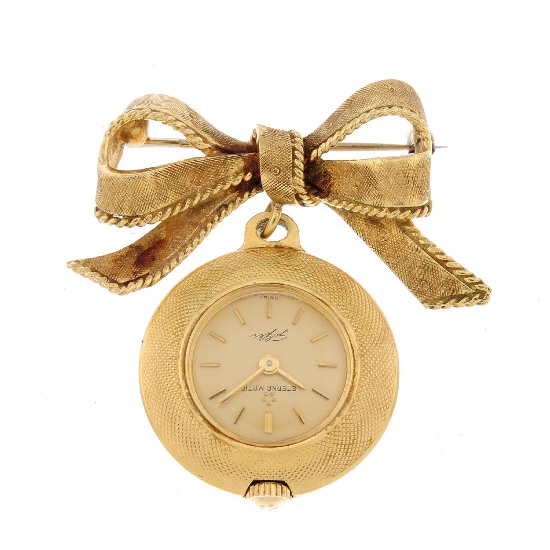 An open face pendent watch by Eterna. Yellow metal case