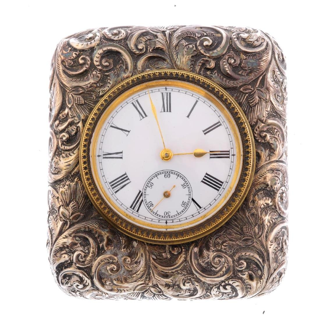 A travel clock. Silver case, hallmarked Birmingham