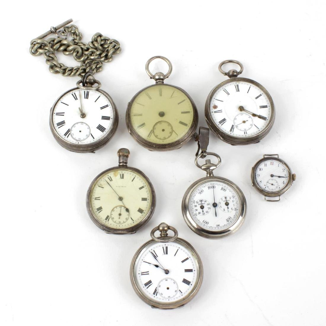 A group of six pocket watches and a silver watch head,