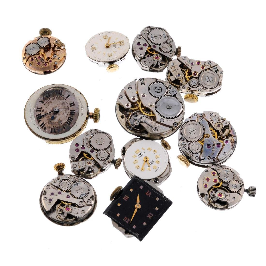 A group of assorted watch movements and watch glasses,