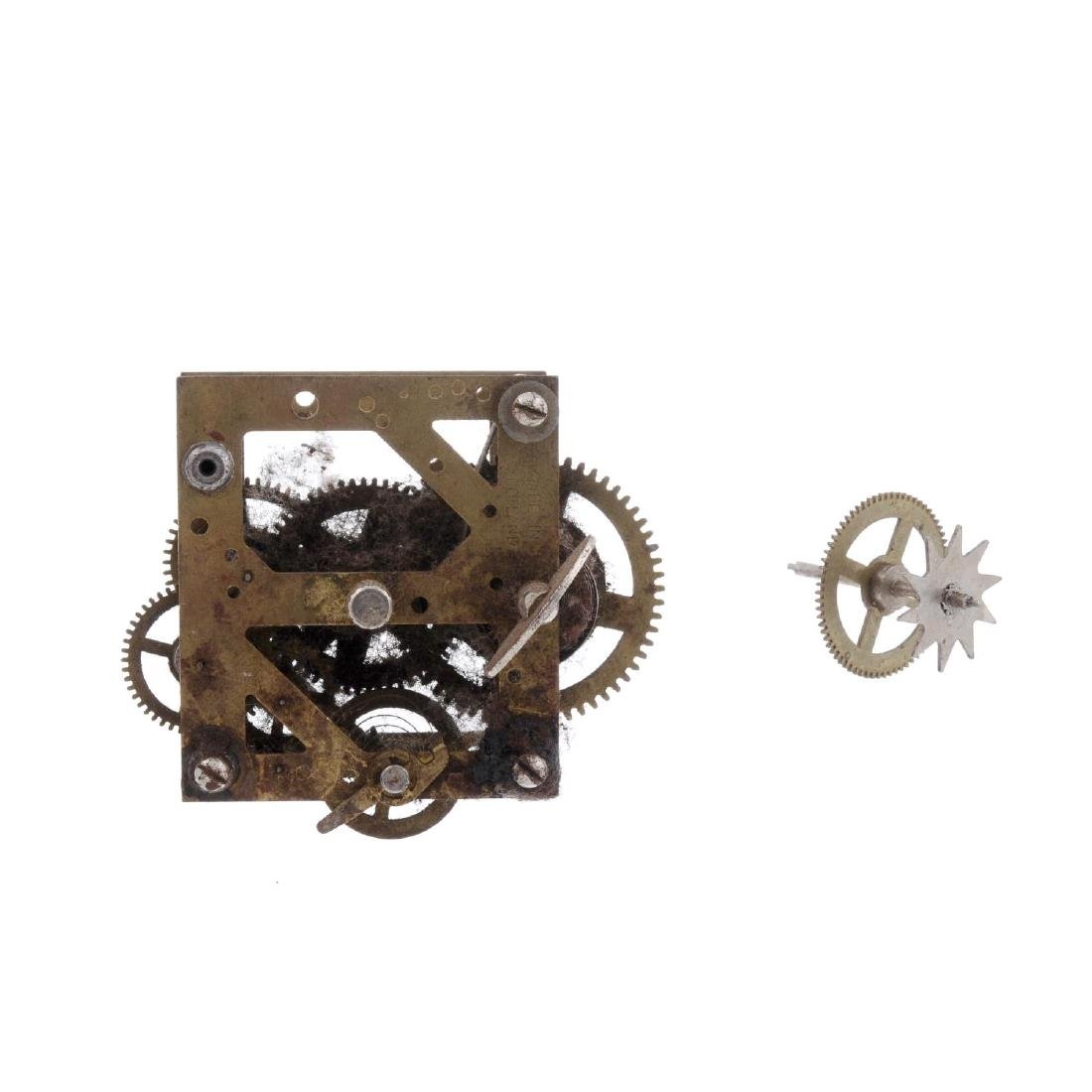 A group of assorted watch and clock parts. All