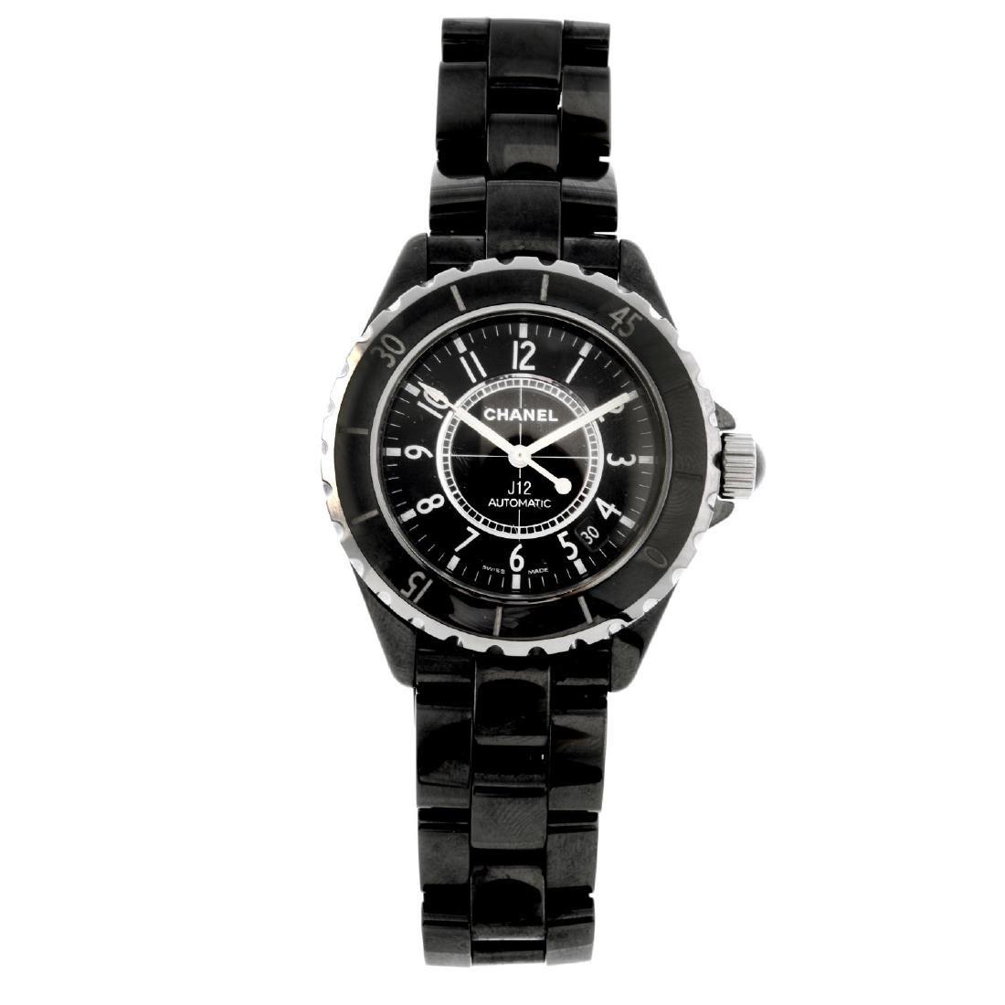 CHANEL - a J12 bracelet watch. Black ceramic case with