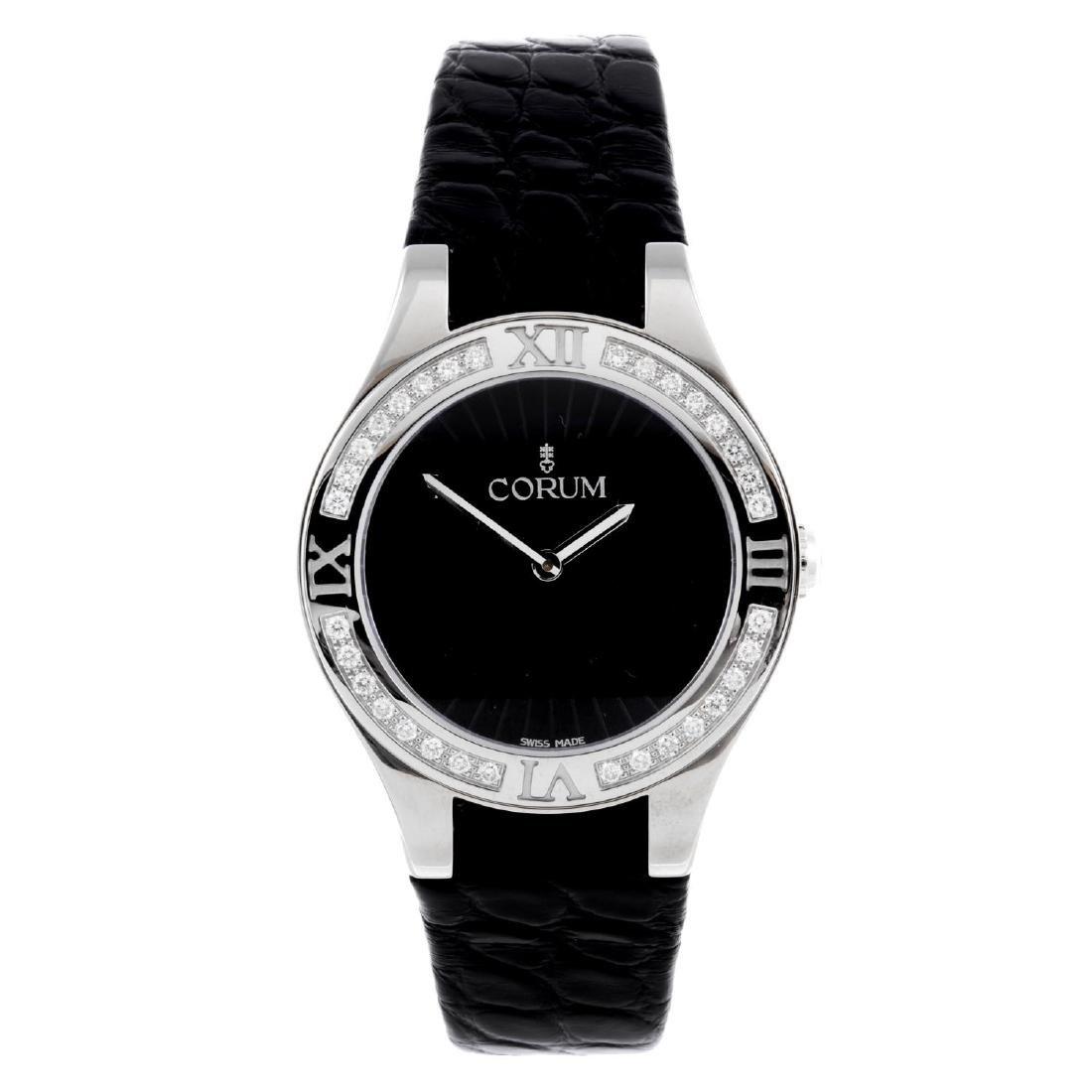 CORUM - a lady's Romulus wrist watch. Stainless steel