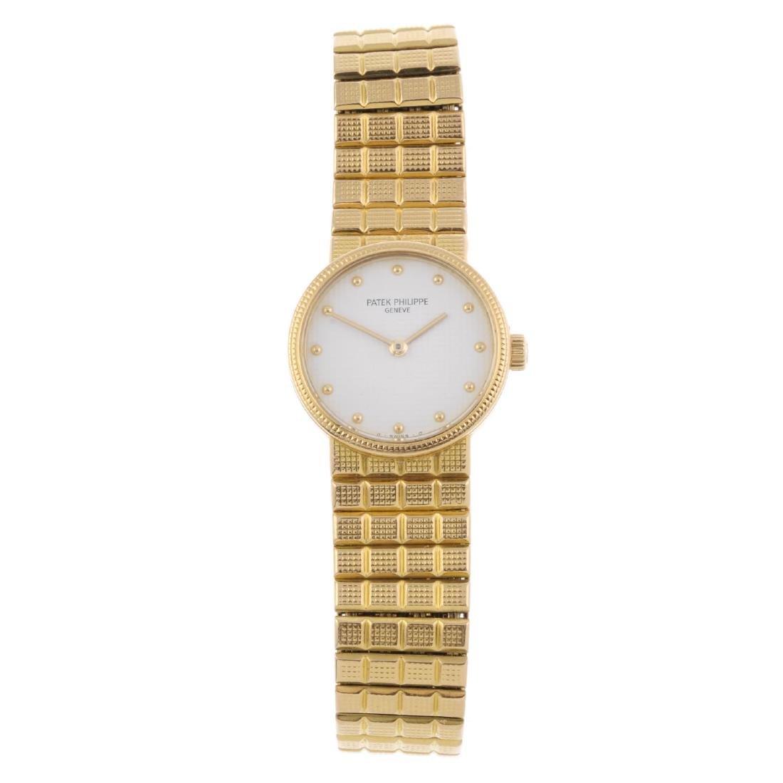 PATEK PHILIPPE - a lady's Calatrava bracelet watch.