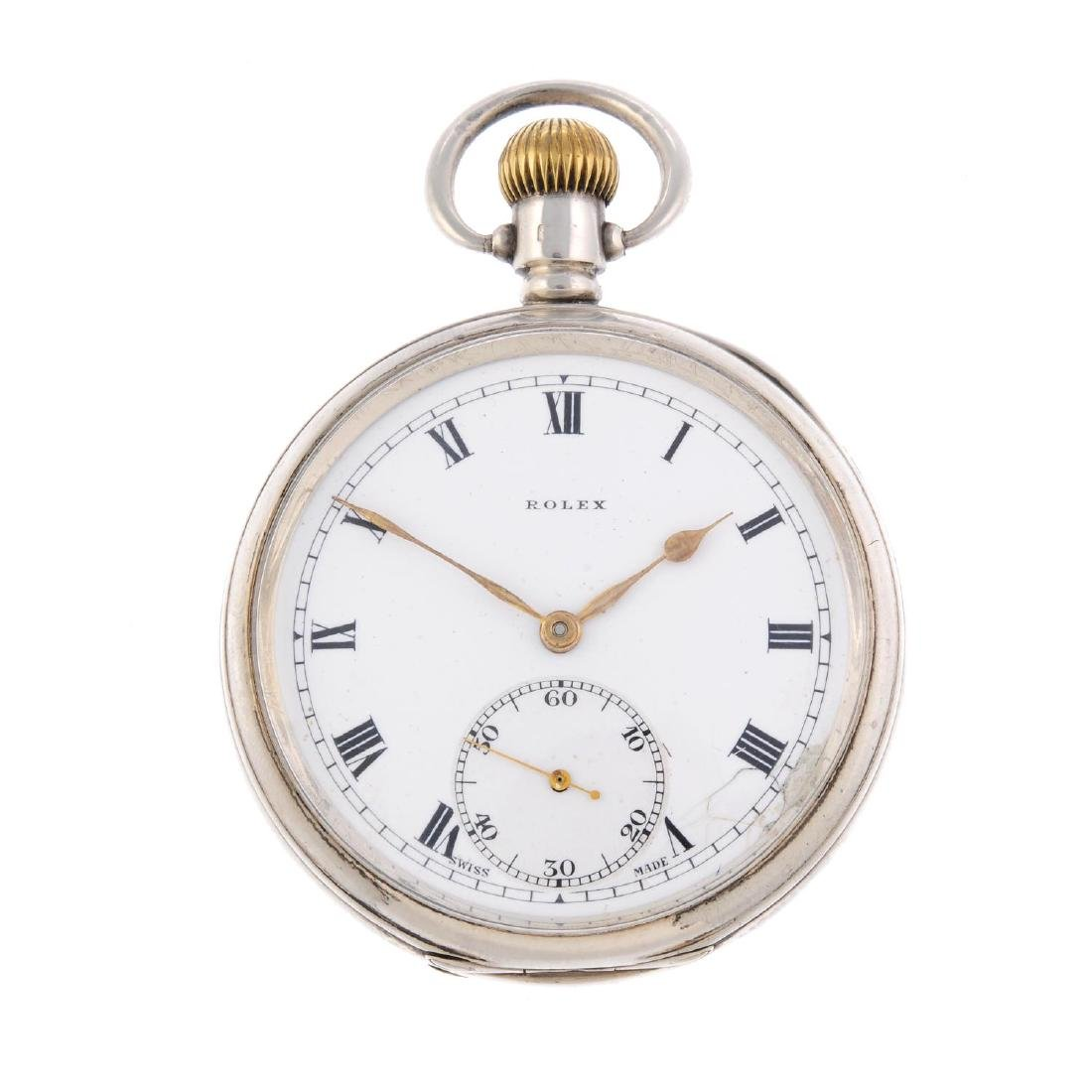An open face pocket watch by Rolex. Silver case,