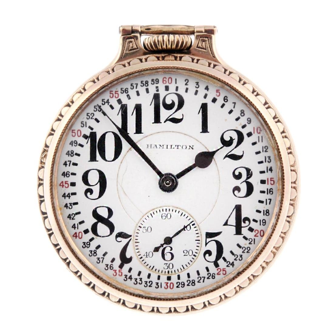 An open face railroad grade pocket watch by Hamilton.