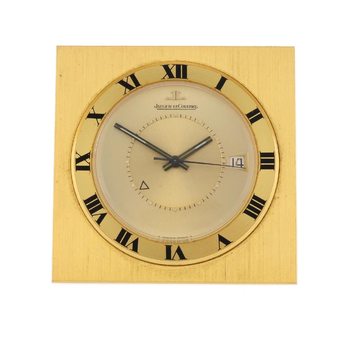 A travel alarm clock by Jaeger-LeCoultre. Gold plated