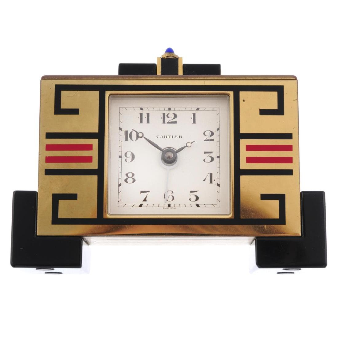 An alarm mantle clock by Cartier. Bi-material case.