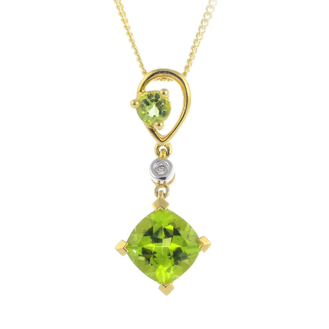 A 9ct gold peridot and diamond pendant. The