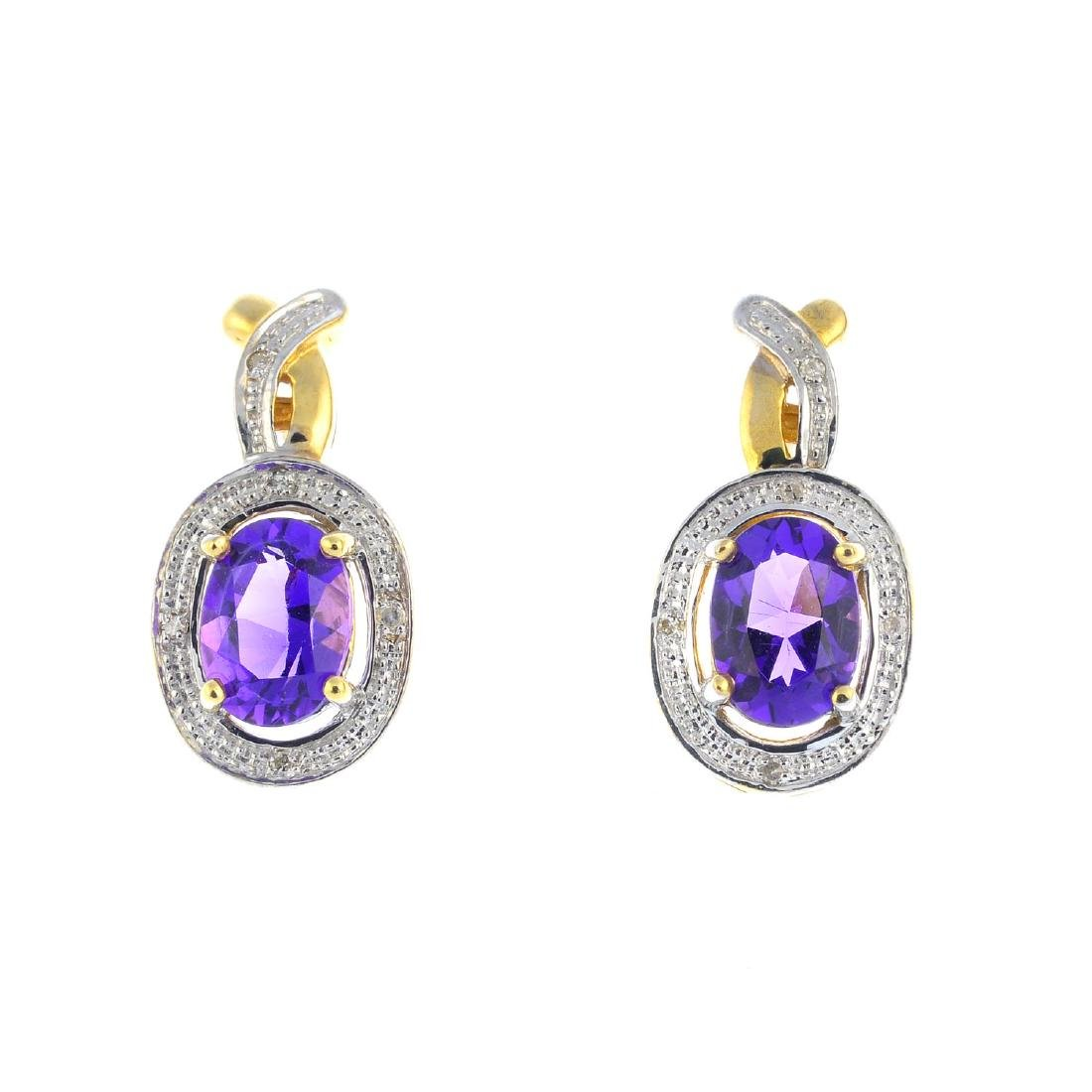 A pair of 9ct gold amethyst and diamond earrings. Each