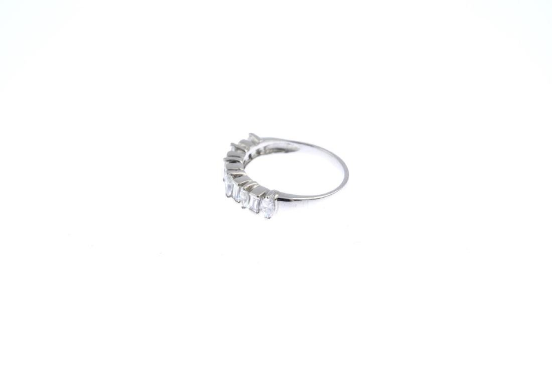 An 18ct gold diamond half eternity ring. The - 2