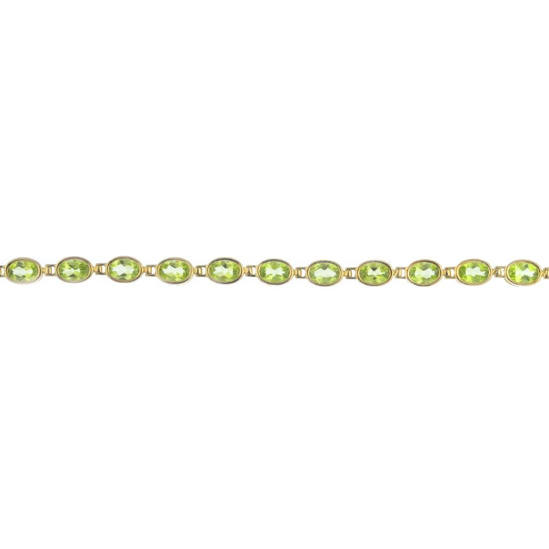 A 9ct gold peridot bracelet. Designed as a series of