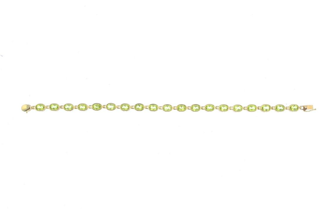 A 9ct gold peridot bracelet. Designed as a series of - 2