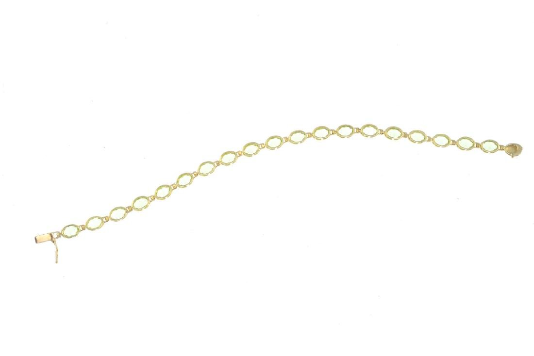 A 9ct gold peridot bracelet. Designed as a series of - 3