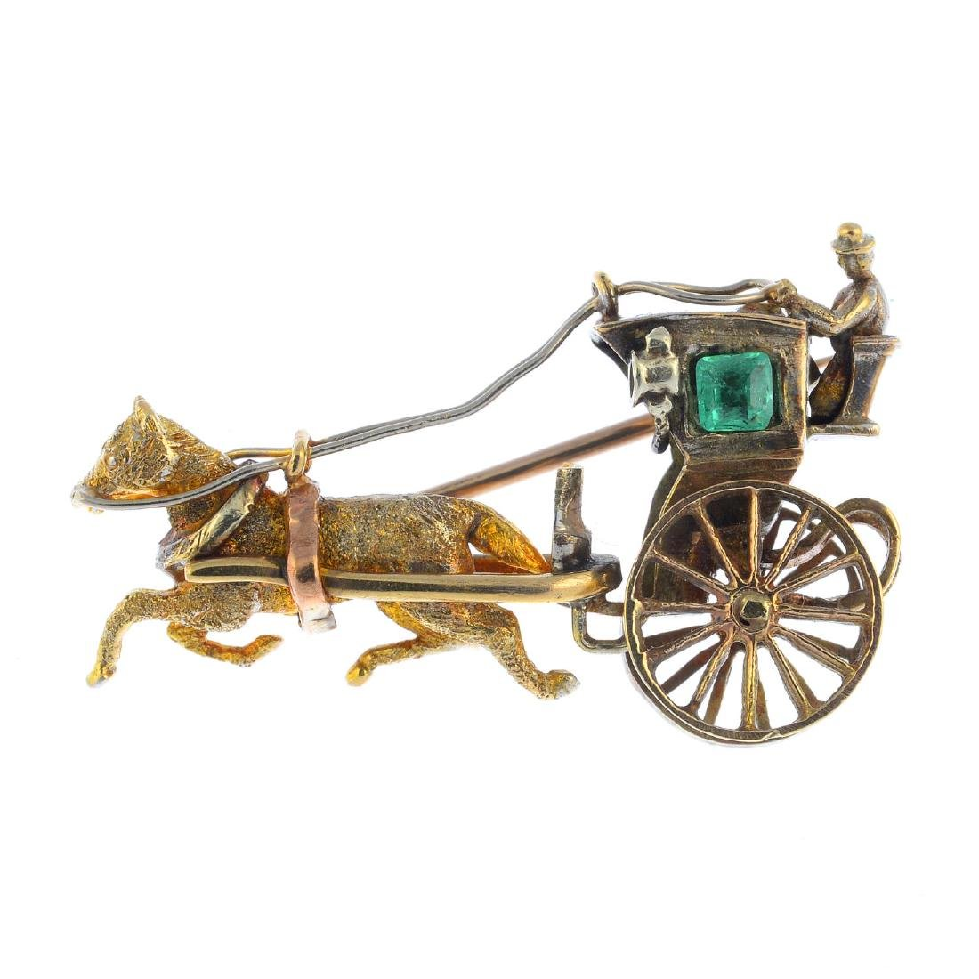 A 1970s 9ct gold emerald brooch. Designed as a horse