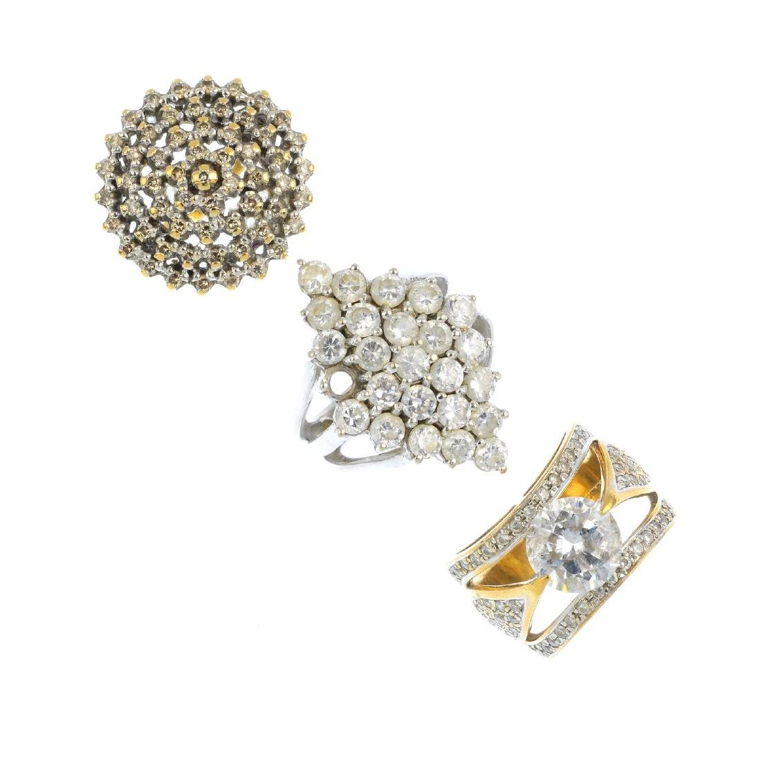 Seven 9ct gold gem-set rings. To include a diamond
