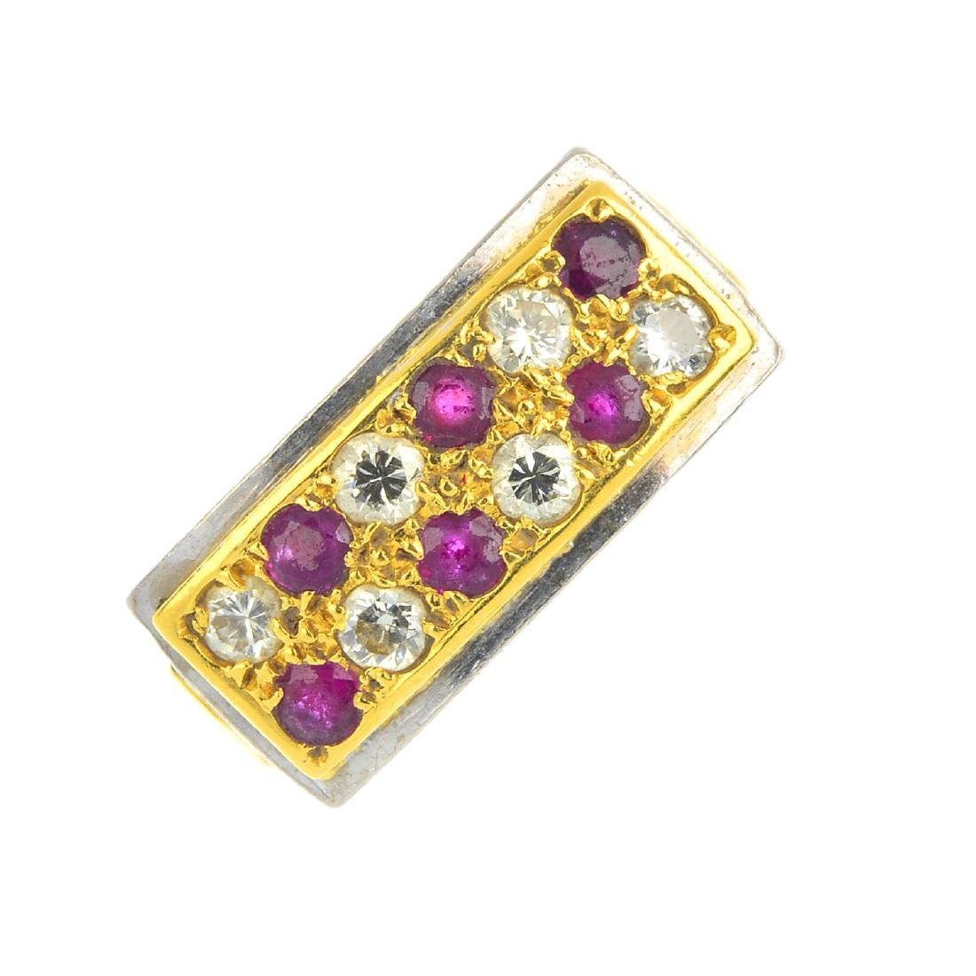 An 18ct gold ruby and diamond dress ring. Designed as