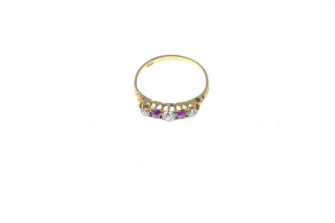 A diamond and ruby five-stone ring. The alternating - 2