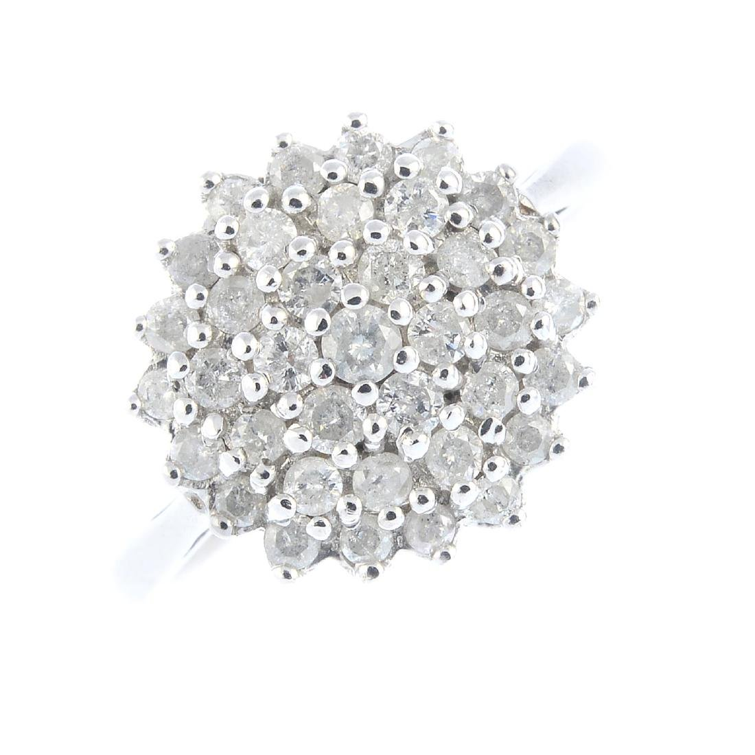 A 9ct diamond cluster ring. Designed as a brilliant-cut