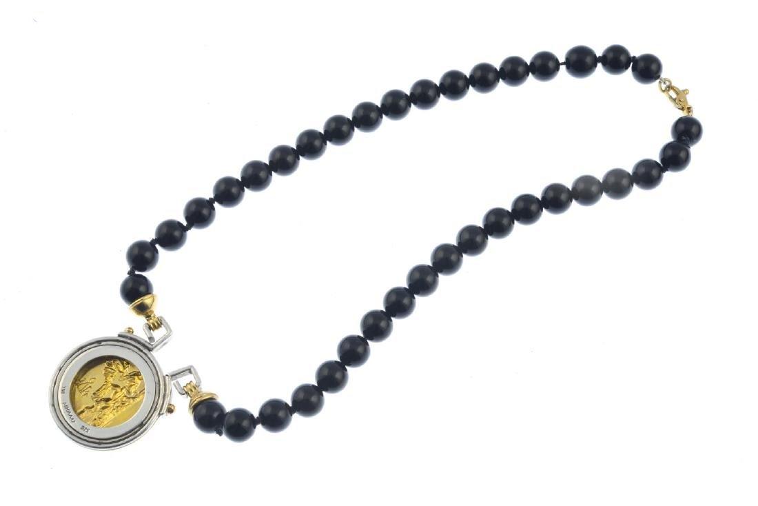 An onyx necklace. Of bi-colour design, the - 2