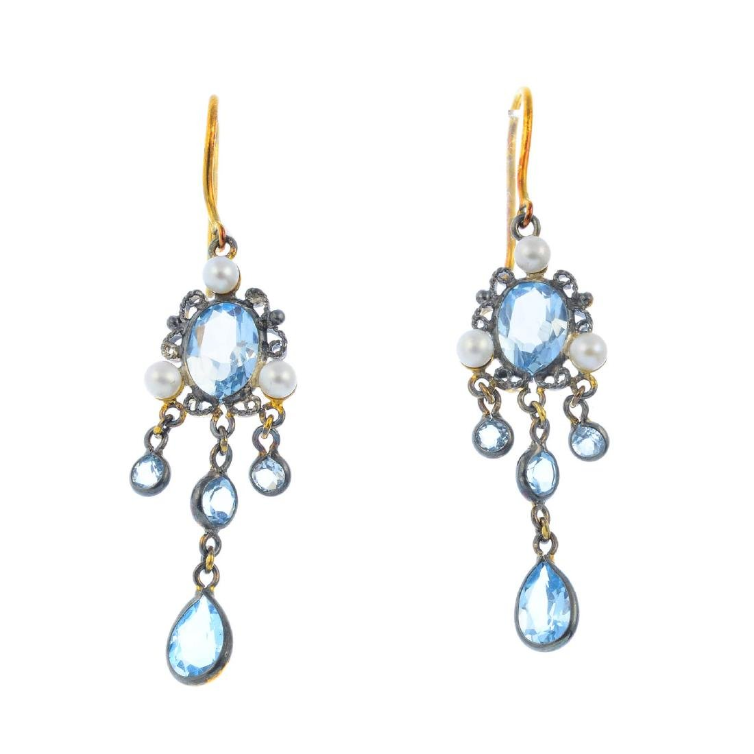 A pair of topaz and seed pearl earrings. Each designed