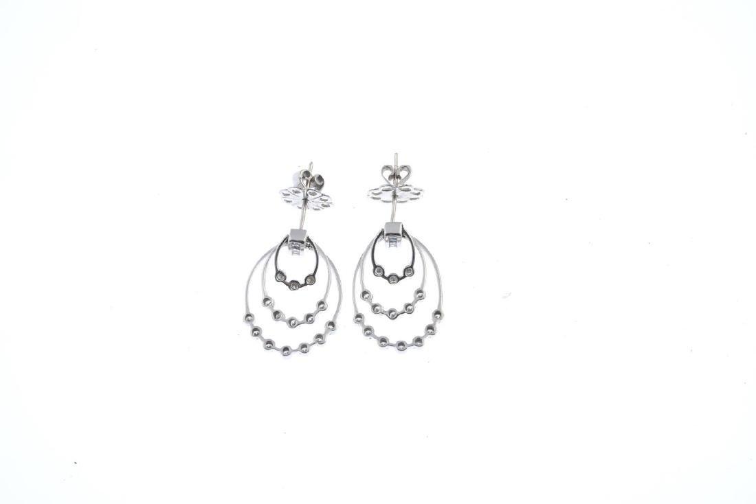 A pair of diamond earrings. Each designed as a - 2