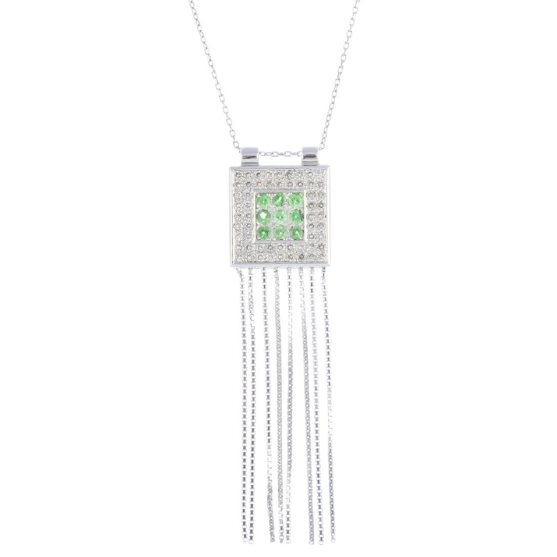 An 18ct gold peridot and diamond pendant. Of square
