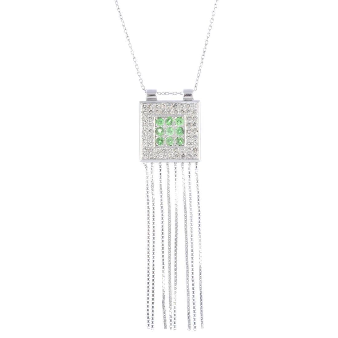 An 18ct gold peridot and diamond pendant. Of square