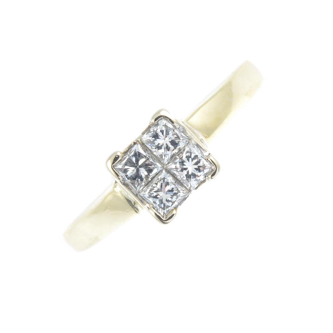 A diamond four-stone ring. The square-shape diamond