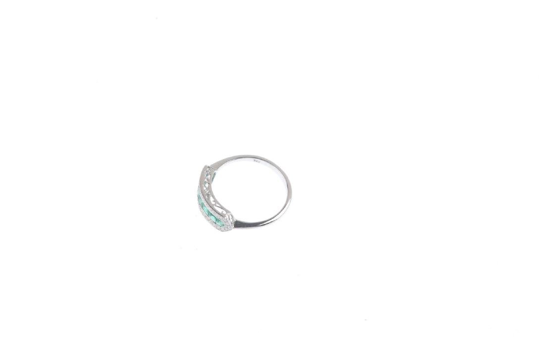 An 18ct gold emerald and diamond dress ring. The - 3